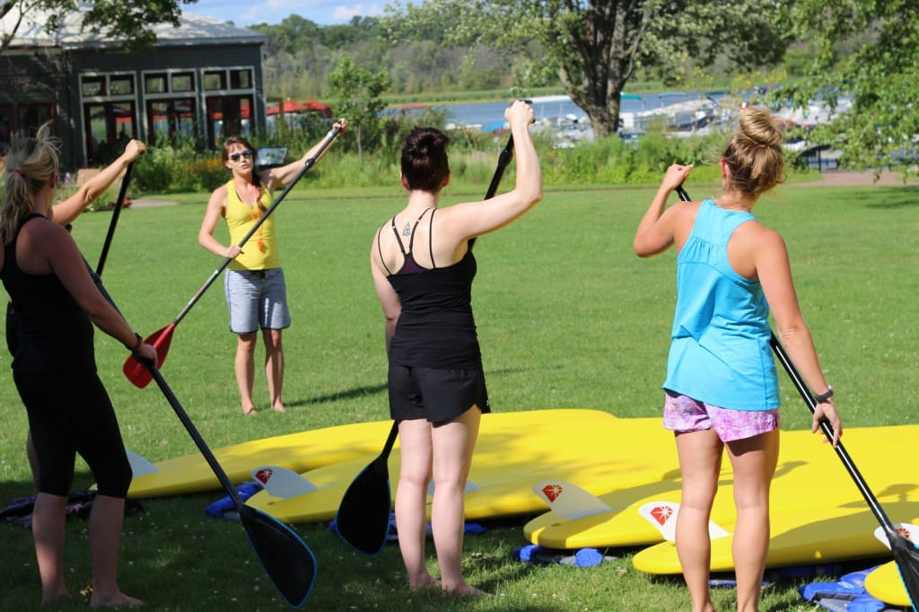 Jen teaching SUP Yoga 101 - Funky Buddha Yoga Hothouse