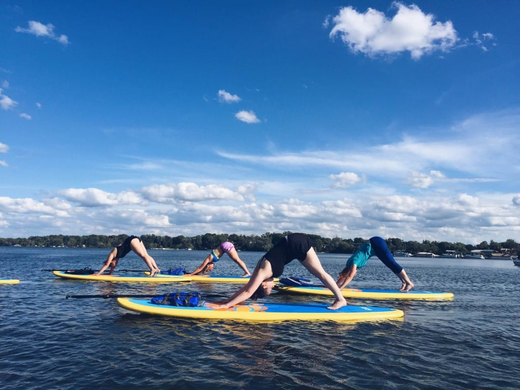 Down dog, SUP yoga style | Funky Buddha Yoga Hothouse